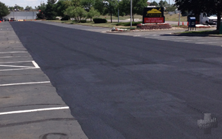 Image of parking lot that has been sealcoated