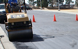 Image of machine performing asphalt surface patching