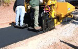 Image of machine laying new asphalt