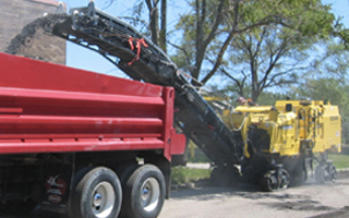 Image of machine milling asphalt